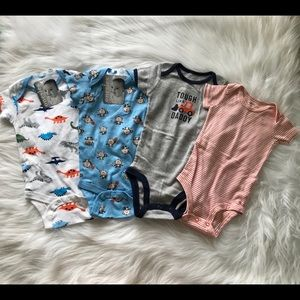 Set of four 6-9 months onesies